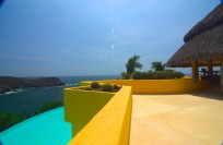 """""""Sol de Oriente"""" and  """"Sol de Occidente"""" on Playa Careyes, two identical 6-Bedroom villas with circular pools and guard towers on opposite ends of El Careyes."""