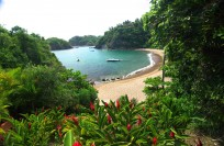Playa Rosa Bay as seen from Casitas pass, idyllic swimming beach with restaurant on the sand