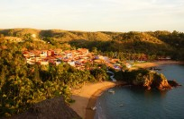 Overview of Playa Rosa with Casitas de las Flores and Playa Careyitos beach with Careyes Hotel (far end)